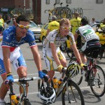 Hincapie and Lewis have their race radios plugged in for Tour of Missouri